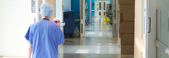 NHS operating staff in hospital corridor